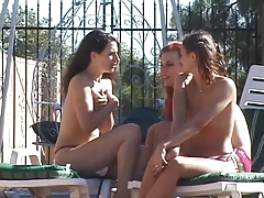 Three  lesbos  plumb with  faux-cocks poolside